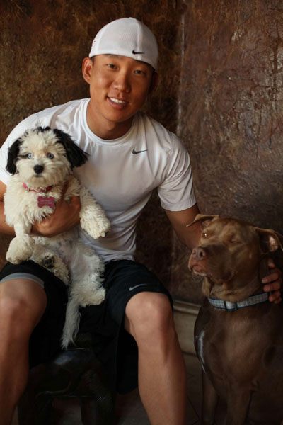 A big dog lover, Kim poses with his dogs.